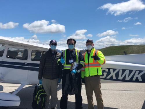 Pilot, Navigator and Spotter ready to go. Safety means wearing a mask and gloves to protect your fellow volunteers.